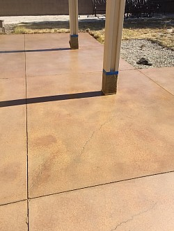 Residential Concrete Patio Staining and Concrete Sealing in a two tone Concrete Stain Color.